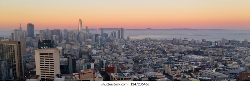 Orange hues seem to bounce off the tallest building as night comes to the San Francisco Bay area