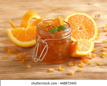 orange jam on wooden background