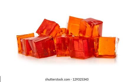 Orange jelly cubes on white background