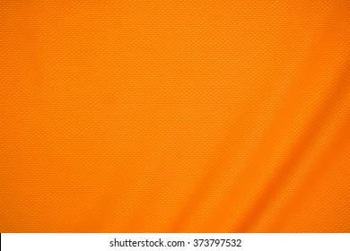 Orange jersey fabric texture background.