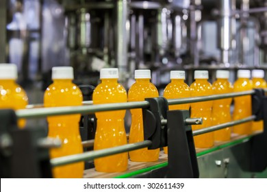 Orange Juice Bottles transfer on Conveyor Belt System