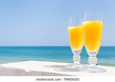 Orange juice by the sea