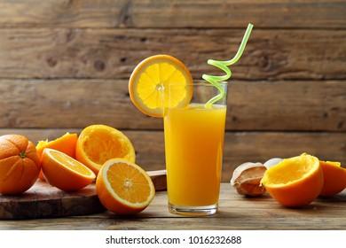 orange juice, citrus juice in glass rustic background