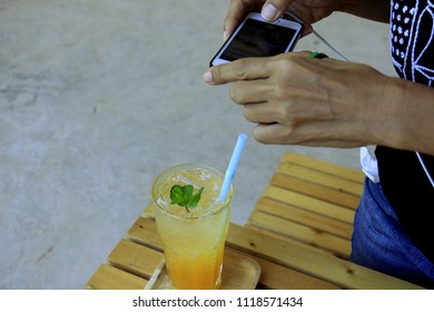 Orange juice In a clear glass with photografer