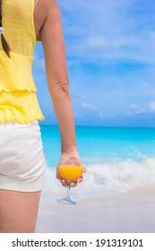 Orange juice in female hand on summer vacation