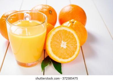 Orange Juice and orange fruit on white table