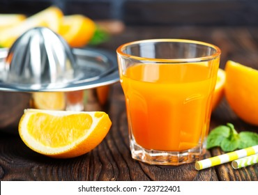 orange juice in glass and fresh fruits