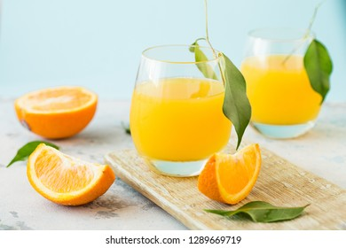 orange juice in glass and fresh slice fruit on table.