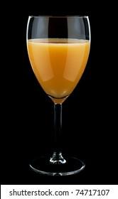 Orange juice glass on the black background
