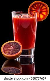 orange juice isolated on a black background