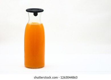 Orange juice jar on white background with copy space.
