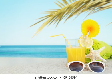 Orange juice on the beach, Concept of summer traveling