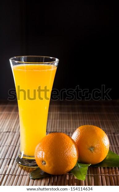 Orange juice on black background