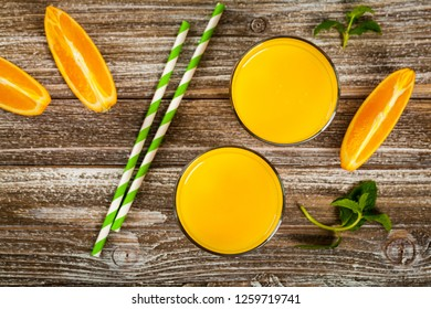 Orange Juice on Wooden Background. Selective focus.