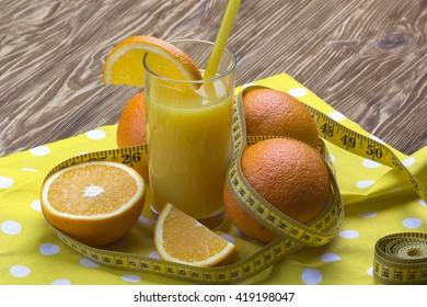 orange juice, oranges and measuring tape