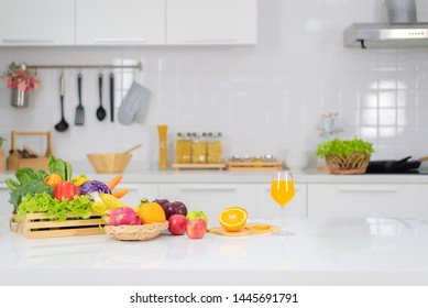 Orange juice is placed on a white table, orange juice, bright colors placed on the table and the atmosphere in the kitchen is clean white.