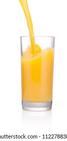Orange juice is pouring into glass isolated on white background