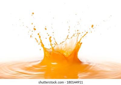 orange juice splashing with ripple against white background