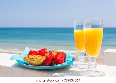 Orange juice, strawberries and pastel de nata