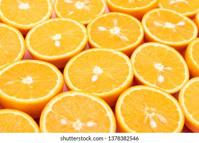 Orange juicy oranges are divided in half lie in a row with each other