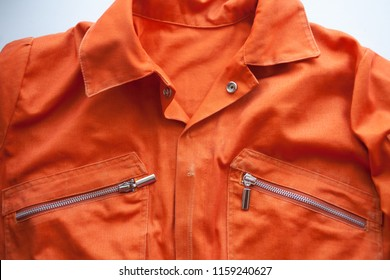 An orange jumpsuit of a prisoner. close up. Prison clothes, prisoner overalls
