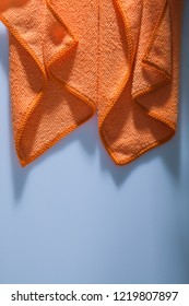 Orange kitchen washcloth on white background.