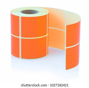 Orange label roll isolated on white background with shadow reflection. Color reel of labels for printers. Labels for direct thermal or thermal transfer printing.