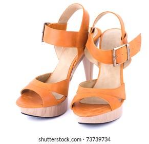 Orange ladies' shoes on a white background