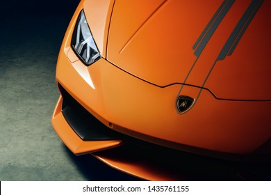 Orange Lamborghini Huracan front end shot with dramatic lighting