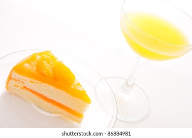 orange layer cake with a cup of orange juice