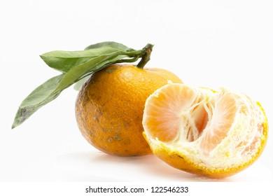 Orange with leaf isolated on isolated white background