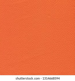 Orange leather textured background. Vintage fashion background for designers and composing collages. Luxury textured genuine leather of high quality.