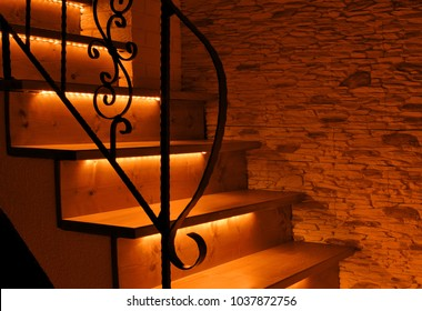 Orange LED lighting wooden stairs with antique railing