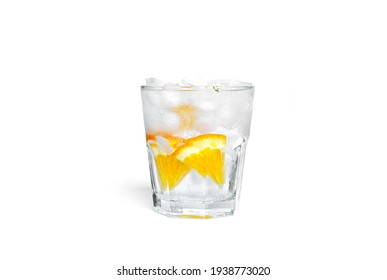 Orange lemonade with ice in a clear glass isolated on a white background. High quality photo
