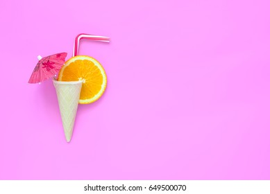 Orange lemonade or some other drink or cocktail creative concept, beach party invitation card template, flat lay, space for a text