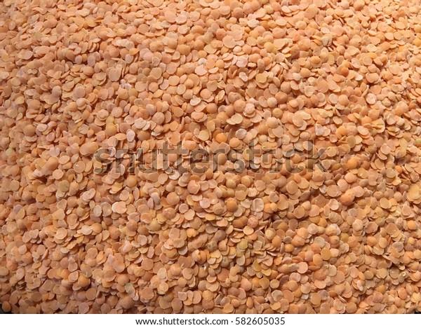 Orange lentils background
