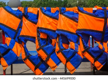 Orange life jackets close up outdoors, safety