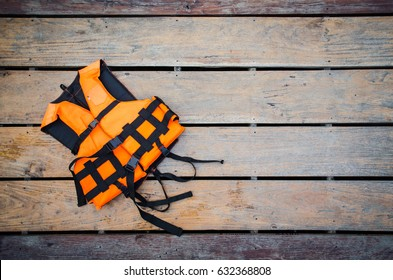 orange life vest on wooden background