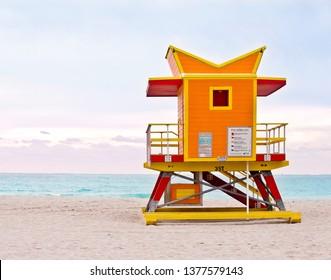 Orange lifeguard tower, art deco Miami Beach life guard stand on South Beach at sunrise