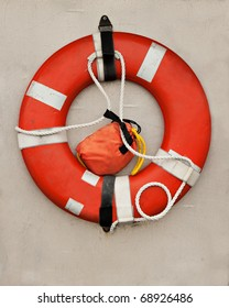 An orange life-preserver, or life-saver, ring hangs on the wall of a boat.