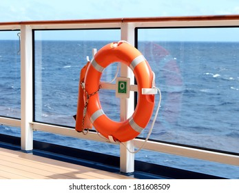 An orange lifesaver on the deck of a cruise ship