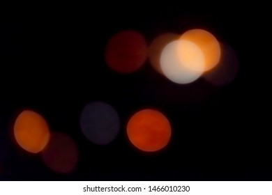 Orange light bokeh abstract texture background with reflections. Circular bright glowing light blurred stock photo