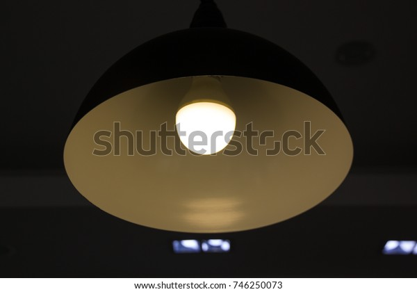 An orange light bulb inside the pendant lamp.This image is designed to make the terminal of lamp is black.