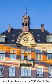 Orange light on the front facade of the courthouse in Aarhus, Denmark