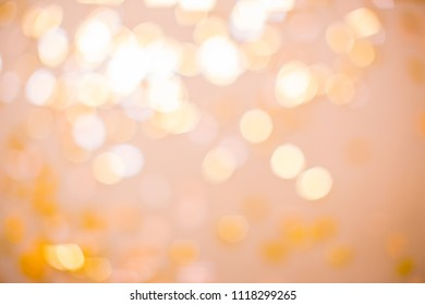 Orange lights with blur. It looks like a holiday with serpentine, glow and brilliance.
