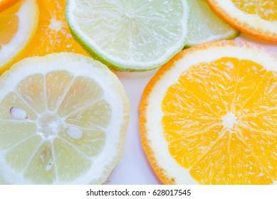 Orange lime and lemon sliced on white background