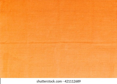 Orange linen tablecloth picnic texture. Textile, napkin, tablecloth. View from above, top. Traditional pattern and color.
