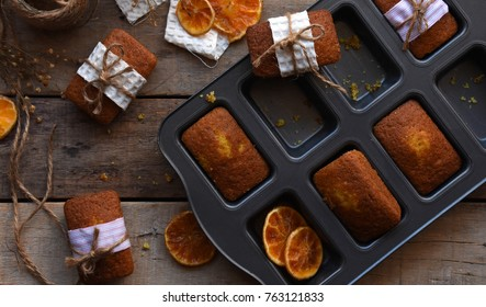 Orange Loaf Cake wrapped for Christmas on a wood table