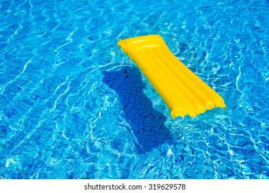 Orange mattress  in a pool