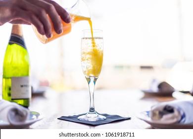 Orange Mimosa Pouring